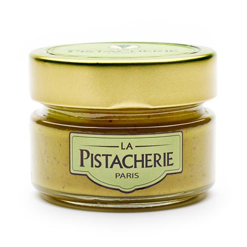 Pot en verre et couvercle doré rempli de pâte de pistache avec le logo La Pistacherie